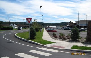 Yield Sign By Shopping Center